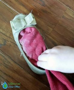 Got stinky shoes? Learn how to banish stinky shoes and feet for good with an all natural stinky shoes remedy. Choose from 3 all natural stinky shoes remedies - essential oils, baking soda, or spray. Many options to choose from. Banish boot odor too. No more stinky kids sports shoes and cleats with these 3 stinky shoes tips! @naturalsoapmom.com #stinkyshoes #myshoesstink #stinkyfeet #naturalremedies #elminatefoododor